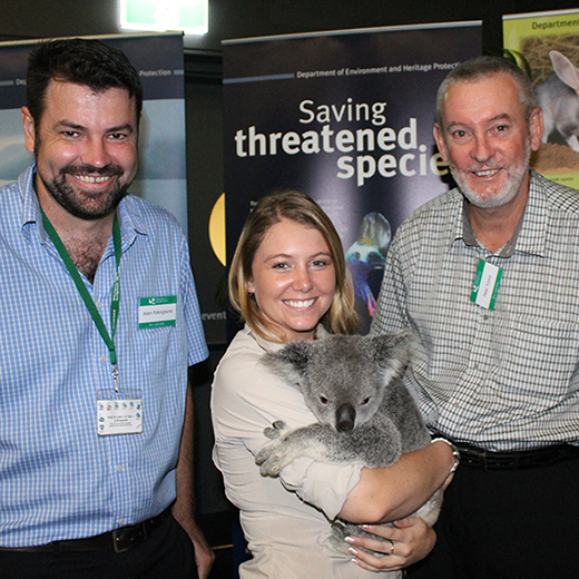Dr Adam Polkinghorne and Professor Peter Timms with a koala and handler from Australia Zoo