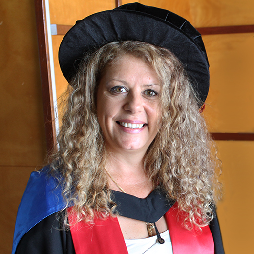 Lynette Maguire in her doctoral cap and gown