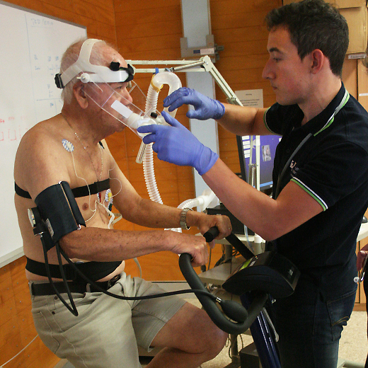 A USC researcher checks the testing equipment on a AAA research participant.