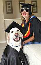 USC graduand Nicole Damarra and her retired Guide Dog, Nev, try on their Graduation gowns