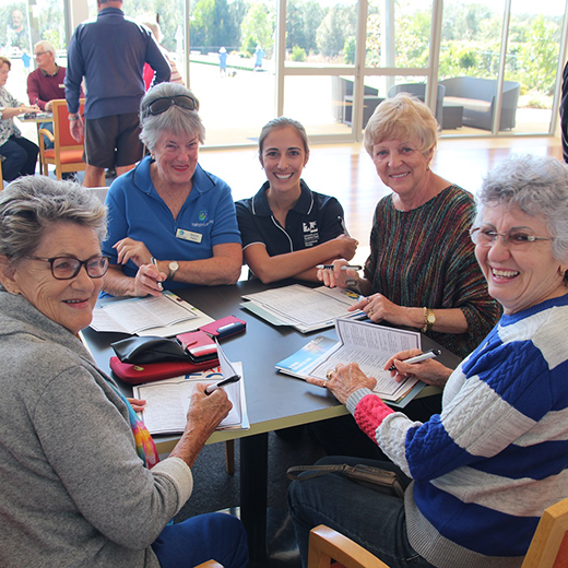 USC Occupational Therapy student Chelsea Skledar (centre) with home owners from the Halcyon Landing over 50s community at Bli Bli.