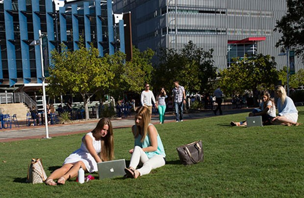 Students relaxing on Sippy Downs campus lawn
