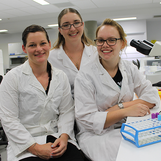 Associate Degree in Medical Laboratory Science graduands (from left) Angie Williams, Danielle Wilkes-Lawson and Jessica Bissell in a laboratory on campus