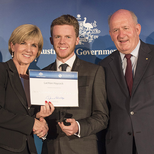 USC student Lachlan Haycock is presented with his New Colombo Plan Scholarship by Australian Foreign Affairs Minister Julie Bishop and Governor-General Sir Peter Cosgrove.