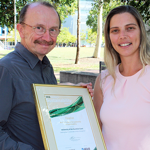 USC Operations Manager Dennis Frost and Sustainability Officer Hailey Bolland with one of the 2016 Queensland Premier's Sustainability Awards.