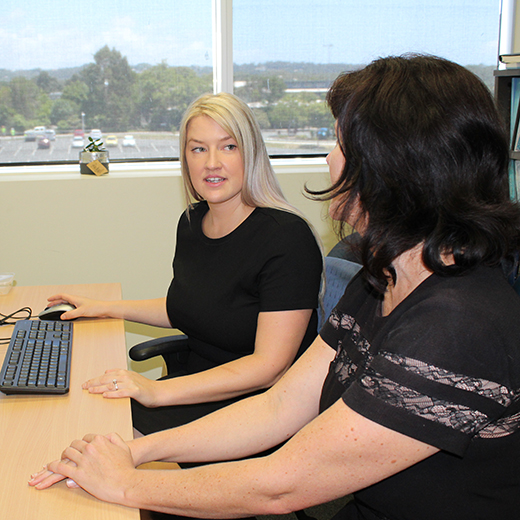 Psychology Honours student Jessica Blower speaks with her supervisor Senior Lecturer in Psychology Dr Rachael Sharman.