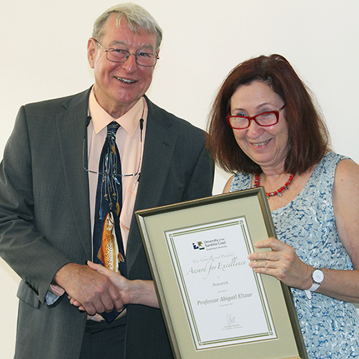 Vice-Chancellor Professor Greg Hill presents Professor Abigail Elizur with an Excellence in Research award