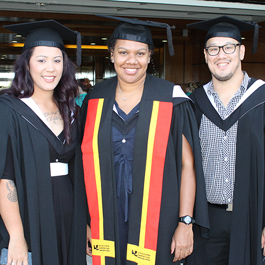 USC Paramedic Science graduates Brooke Stevenson, Penelope Beezley (wearing an Indigenous Australian stole) and Julian Do at a 2016 graduation ceremony.