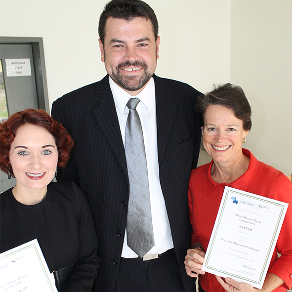 Associate Professor Adam Polkinghorne with Three Minute Thesis competition runner-up Jacqueline Burgess and winner Paula Loveday