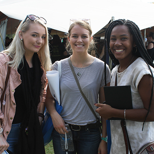 Iesha McKinnon, Kelly Gonoude and Kara Rollock visiting the Market Day stalls during USC's Orientation Week.