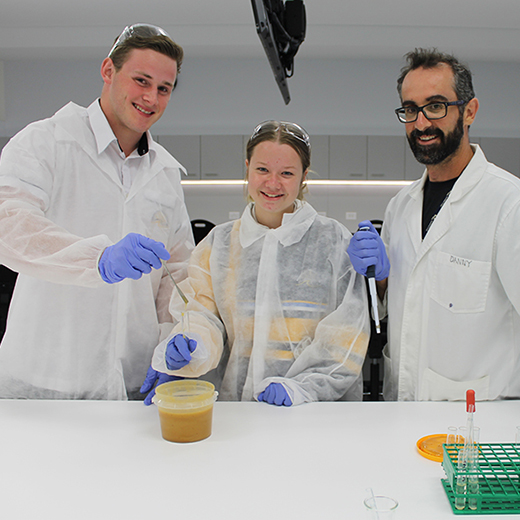 Bribie Island State High School students Brydon Crouch and Eloise Bullard with USC's Daniel Meloncelli at a 2016 chemistry workshop at USC.