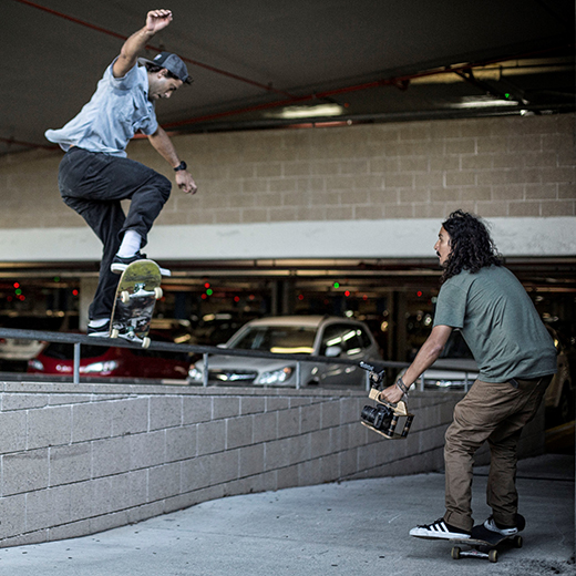 USC graduate Marcos Pereira of Brazil filming international skateboarding competitor Nilo Peçanha at a shoot for Converse CONS on the Gold Coast