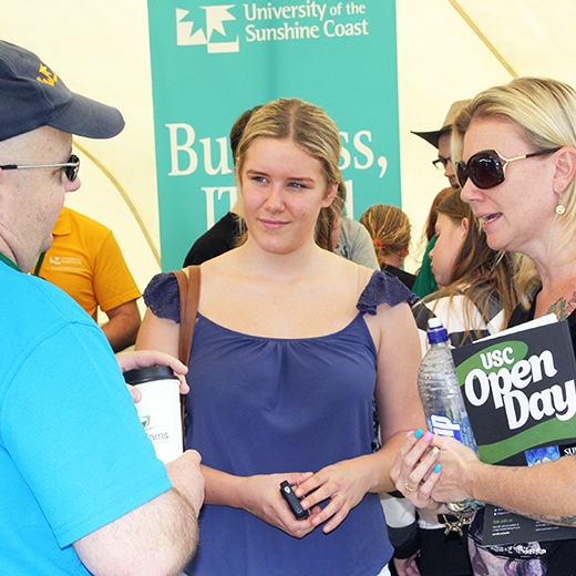 Business academic Dr Peter Baxter speaks with visitors to USC's Open Day
