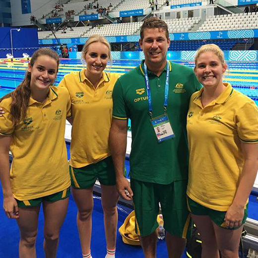 Sixteen-year-old Kaylee McKeown and USC students Leah Neale and Taylor McKeown – pictured in Budapest with Spartans coach Chris Mooney