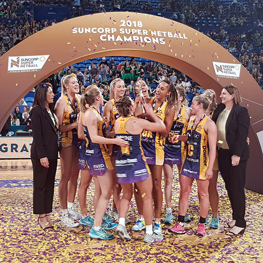 Sunshine Coast Lightning players and coaches celebrate their grand final win over the West Coast Fever