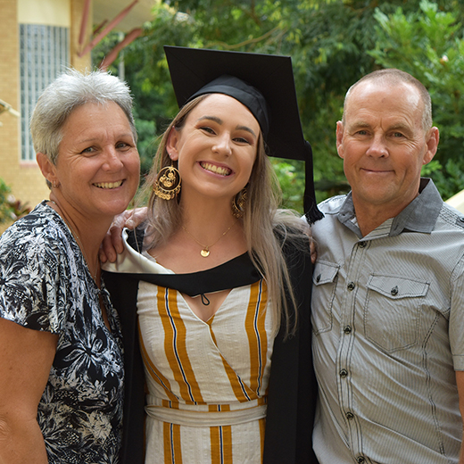 Ashley Black with her parents Kasey and Mark Black at her USC graduation ceremony at the Sunshine Coast today