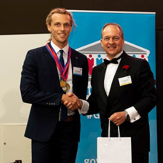 USC student Shaun Hayward of Currimundi receiving an award on behalf of his team from Infosys Senior Vice-President Andrew Groth at the GovHack International Red Carpet Awards in Canberra.