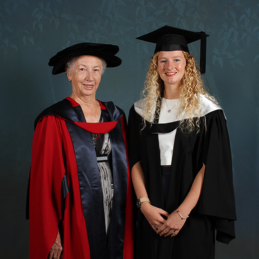 Philanthropist Laurie Cowled, left, with 2018 graduate Sally Watson. Photo Reed Graduation Services