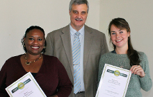 Three Minute Thesis contest winners Katryna Starks and Jennie Chandler with Professor Roland De Marco