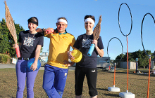 USC Quidditch players Alise Thomas, Tiernan Walker and Abbey Crook prepare for a match