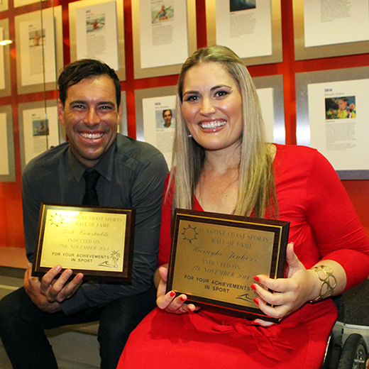 Josh Constable and Marayke Jonkers hold their hall of fame awards